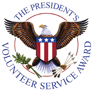 presidential volunteer service award with american eagle with blue red white lettering and flag with arrows and olive branch in talons